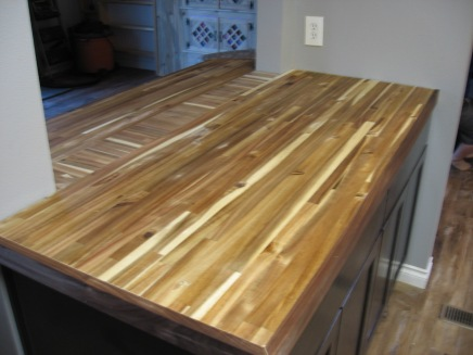 Kitchen counter top in progress. Butcher-block with walnut trim. Backsplash to be added next.